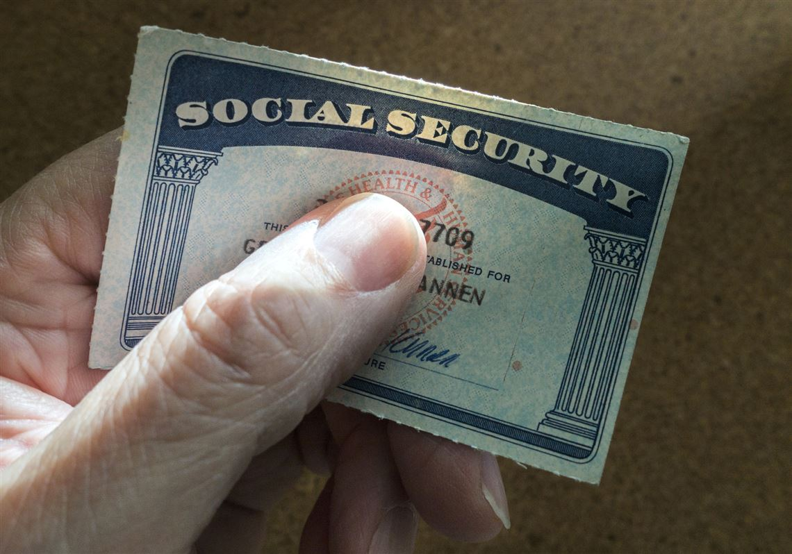 man-holding-social-security-card-1551202888
